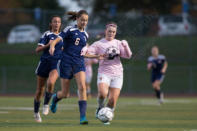 Sheehan's Bethany Gray is challenged by Lyman Hall's Carly Jacobs Wednesday at Riccitelli Field in Wallingford October 25, 2017 | Justin Weekes / For the Record-Journal