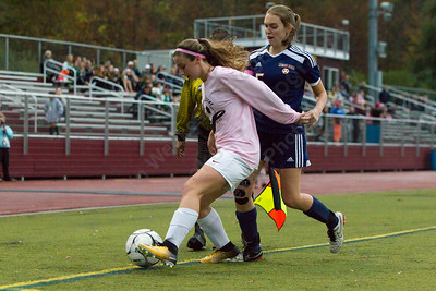 Sheehan's Olivia Cuticelli tries to keep the ball in play Wednesday at Riccitelli Field in Wallingford October 25, 2017 | Justin Weekes / For the Record-Journal