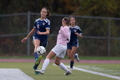 Lyman Hall's Carly Jacobs sends a pass up field Wednesday at Riccitelli Field in Wallingford October 25, 2017 | Justin Weekes / For the Record-Journal