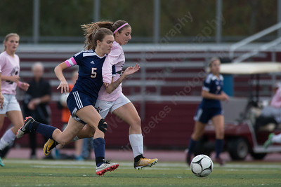 Lyman Hall's Katelyn Smith and Sheehan's Olivia Cuticelli chase a loose ball Wednesday at Riccitelli Field in Wallingford October 25, 2017 | Justin Weekes / For the Record-Journal