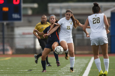 Lyman Hall's Chelsea Giannini and East Haven's Christina Fazzino vie for possession Thursday at Fitzgerald Field on the campus of Lyman Hall in Wallingford September 20, 2018 | Justin Weekes / Special to the Record-Journal