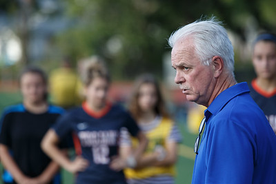 Lyman Hall's head coach Tony Crane talks with players at half time Thursday at Fitzgerald Field on the campus of Lyman Hall in Wallingford September 20, 2018 | Justin Weekes / Special to the Record-Journal