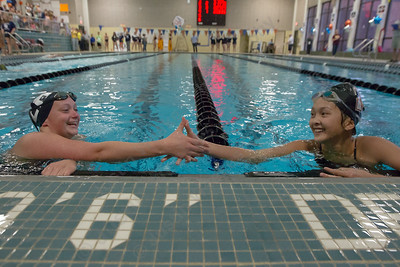 Sheehan's Amy Bui right congratulates Lyman Hall's Faith Gambardella after the 200 freestyle Tuesday at Sheehan High School Pool in Wallingford October 17, 2017 | Justin Weekes / For the Record-Journal