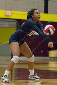 Lyman Hall's Aliyah Hunter digs a Sheehan serve Monday at Sheehan High School in Wallingford September 11, 2017 | Justin Weekes / For the Record-Journal