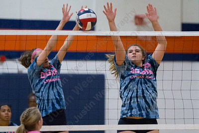 Lyman Hall's Hailey Bruneau left and Avery LaChance jump to block a Sheehan spike Thursday at Lyman Hall High School in Wallingford October 5, 2017 | Justin Weekes / For the Record-Journal
