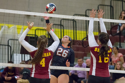 Lyman Hall's Avery LaChance gets a spike through Monday at Sheehan High School in Wallingford September 11, 2017 | Justin Weekes / For the Record-Journal