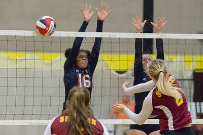 Sheehan's Macey Sundwall gets a spike past Lyman Hall's blockers Monday at Sheehan High School in Wallingford September 11, 2017 | Justin Weekes / For the Record-Journal