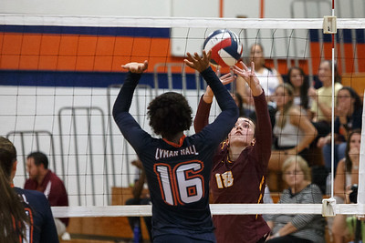 Sheehan's Lydia Dellipoali plays a touch over blockers Tuesday at Lyman Hall High School in Wallingford September 11, 2018 | Justin Weekes / Special to the Record-Journal