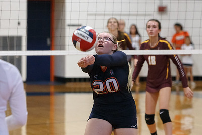 Lyman Hall's Nicole Albert digs a volley Tuesday at Lyman Hall High School in Wallingford September 11, 2018 | Justin Weekes / Special to the Record-Journal