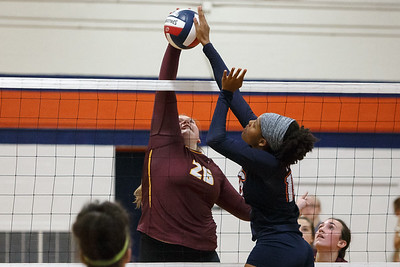 Lyman Hall's Elyssa West blocks Sheehan's Caitlyn Hunt Tuesday at Lyman Hall High School in Wallingford September 11, 2018 | Justin Weekes / Special to the Record-Journal