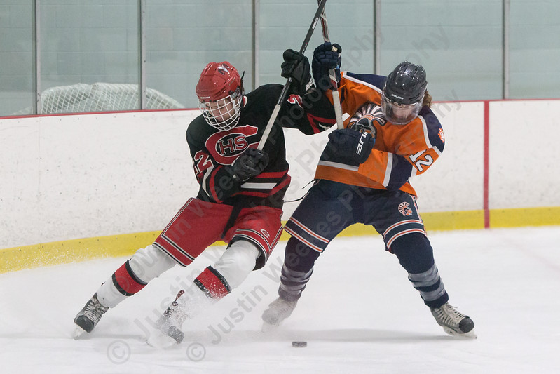 Lyman Hall's Thomas Isleib and Cheshire's Benjamin O'Connor battle for possession Tuesday at the Northford Ice Pavilion in Northford December 19, 2017 | Justin Weekes / For the Record-Journal