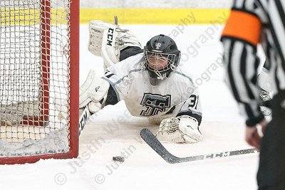 Tri-Town's Peyton Emrick dives across the crease to stop a shot Thursday during the CIAC D-III quarterfinal round at Koeppel Community Sports Center on the campus of Trinity College in Hartford March 8, 2018 | Justin Weekes / Special to the Record-Journal