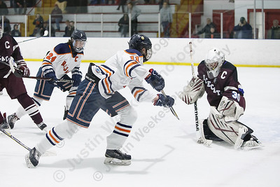 Lyman Hall HK Coginchaug's Matt Pettit tries to direct a rebound past BBD's Stephen Fanning  Wednesday during the SCC semifinals at Milford Ice Pavilion in Milford February 28, 2018 | Justin Weekes / Special to the Record-Journal