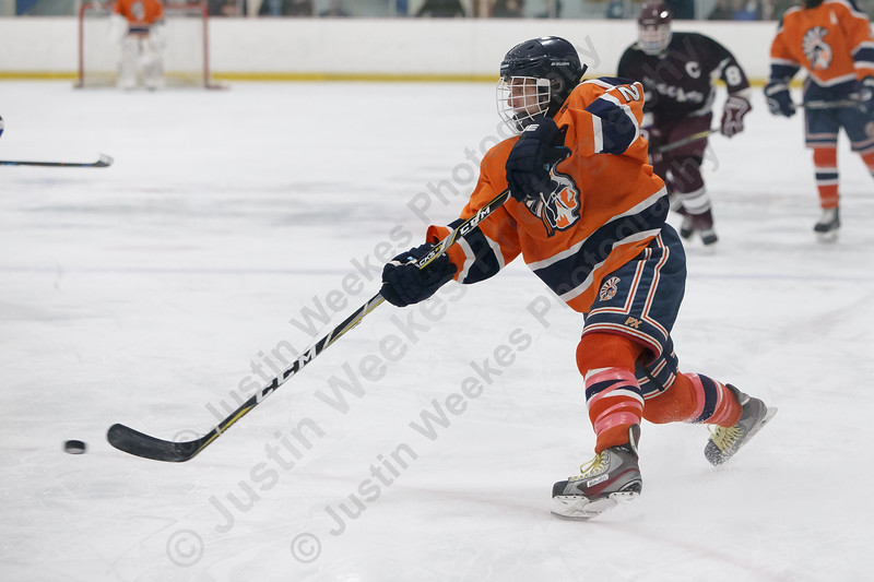 Lyman Hall's Thomas Isleib gets a shot off Wednesday at the Northford Ice Pavilion in Northford February 14, 2018 | Justin Weekes / Special to the Record-Journal