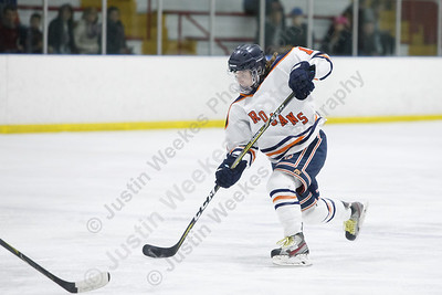 Lyman Hall HK Coginchaug's Thomas Isleib puts in a shot from the blue line on a power play Wednesday during the SCC semifinals at Milford Ice Pavilion in Milford February 28, 2018 | Justin Weekes / Special to the Record-Journal
