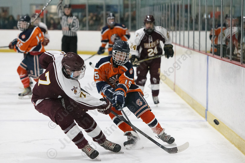 Lyman Hall's TJ Arduini tries to keep the puck in the zone from Sheehan's Tyler Jackson Sunday at the Northford Ice Pavilion in Northford February 18, 2018   Justin Weekes / Special to the Record-Journal