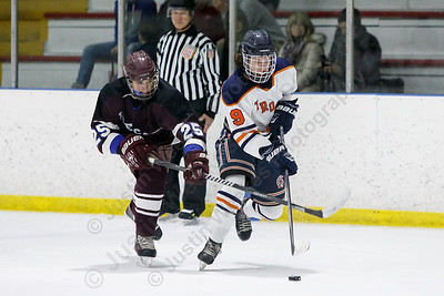 Lyman Hall HK Coginchaug's Conner Satton gets past BBD's Joe Stefanelli  Wednesday during the SCC semifinals at Milford Ice Pavilion in Milford February 28, 2018 | Justin Weekes / Special to the Record-Journal