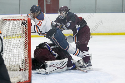 Lyman Hall HK Coginchaug's Matt Pettit gets cross checked into BBD's goalie Stephen Fanning Wednesday during the SCC semifinals at Milford Ice Pavilion in Milford February 28, 2018 | Justin Weekes / Special to the Record-Journal