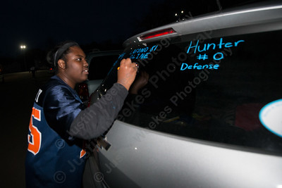 Lyman Hall's Jaylona Murphy decorates her car Tuesday during the Lyman Hall and Sheehan Powder Puff Motorcade in Wallingford November 21, 2017 | Justin Weekes / For the Record-Journal