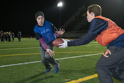 Lyman Hall's Jessica Boutin takes the hand off from Michaela Keating Sunday during powder puff practice at Fitzgerald Field on the campus of Lyman Hall High School in Wallingford November 12, 2017 | Justin Weekes / For the Record-Journal