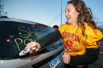 Sheehan's Stephanie Phoenix decorates her car Tuesday during the Lyman Hall and Sheehan Powder Puff Motorcade in Wallingford November 21, 2017 | Justin Weekes / For the Record-Journal