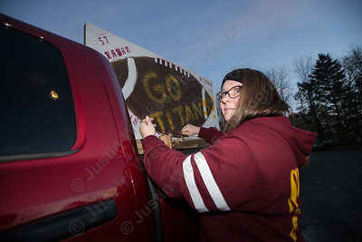 Sheehan's leah Karaban puts the finishing touches on her truck Tuesday during the Lyman Hall and Sheehan Powder Puff Motorcade in Wallingford November 21, 2017 | Justin Weekes / For the Record-Journal