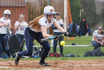 Lyman Hall's Kim Petit (12) bunts a pitch from Cheshire's MacKenzie Juodaitis (4)  late in the count Wednesday at Lyman Hall High School in Wallingford  Apr. 22, 2015 | Justin Weekes / For the Record-Journal