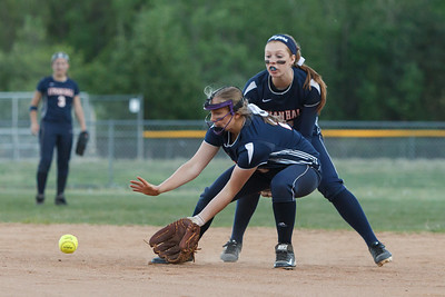 Lyman Hall's Katelyn Miller (21) fields a grounder from Sheehan's Kelly Brosnan (1) Wednesday at Pragemann Park in Wallingford  May. 13, 2015 | Justin Weekes / For the Record-Journal