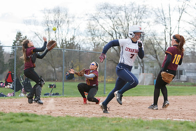 Sheehan's Mikaeyla Daddio (7) catches a fly ball from Lyman Hall's Lexie Tangredi (7) Monday at Lyman Hall High School in Wallingford  Apr. 27, 2015 | Justin Weekes / For the Record-Journal