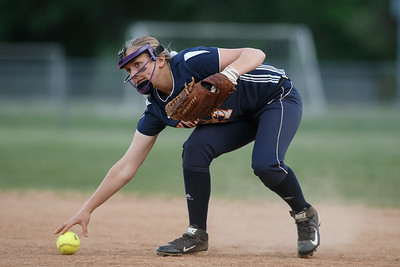 Lyman Hall's Katelyn Miller (21) fields a grounder from Kelly Brosnan (1) Wednesday at Pragemann Park in Wallingford  May. 13, 2015 | Justin Weekes / For the Record-Journal