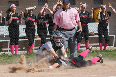 Cheshire's Olivia Odermatt (5) gets tagged out at home by Lyman Hall's Cassie Smith (8) Monday at Cheshire High School in Cheshire  May. 11, 2015 | Justin Weekes / For the Record-Journal