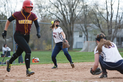 Lyman Hall's Sam Carbone (24) throws out Sheehan's Missy Pereira (19) at first Monday at Lyman Hall High School in Wallingford  Apr. 27, 2015 | Justin Weekes / For the Record-Journal