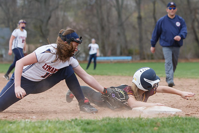 Lyman Hall's Michaela Keating (10) tries to catch Sheehan's Becca Souza (13) at first Monday at Lyman Hall High School in Wallingford  Apr. 27, 2015 | Justin Weekes / For the Record-Journal