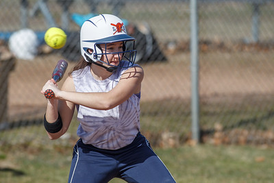 Lyman Hall's Morgan Shura waits on a high pitch Monday during a scrimmage at Lyman Hall High School in Wallingford  Apr. 6, 2015 | Justin Weekes / For the Record-Journal