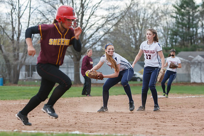 Lyman Hall's Kim Petit (12) throws out Sheehan's Mikaeyla Daddio (7) Monday at Lyman Hall High School in Wallingford  Apr. 27, 2015 | Justin Weekes / For the Record-Journal