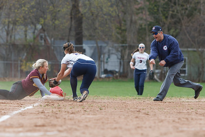 Sheehan's Becca Souza (13) looks back for the call at third as Lyman Hall's Sam Carbone (24) tags her out Monday at Lyman Hall High School in Wallingford  Apr. 27, 2015 | Justin Weekes / For the Record-Journal