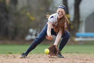 Lyman Hall's Kim Petit (12) fields a ground ball from Sheehan's Meghan Gavin (11) Monday at Lyman Hall High School in Wallingford  Apr. 27, 2015 | Justin Weekes / For the Record-Journal