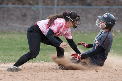 Sheehan's Nicole Dorsey tags out a steeling Lyman Hall's Paige Hansen Wednesday at Pragemann Park in Wallingford April 18, 2018 | Justin Weekes / Special to the Record-Journal