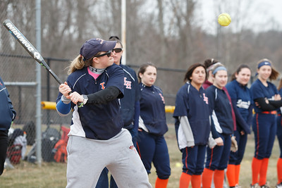 Lyman Hall's head coach Stephanie Lavado-Berghorn hits for infield warm ups Wednesday during a pre-season scrimmage with Choate Rosemary Hall at Lyman Hall High School in Wallingford March 28, 2018 | Justin Weekes / Special to the Record-Journal