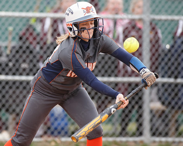 Lyman Hall's Kate Miller gets a bunt to drop Wednesday at Pragemann Park in Wallingford April 18, 2018 | Justin Weekes / Special to the Record-Journal