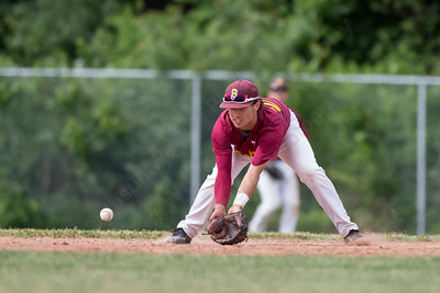 Sheehan's Sal Gozzo (27) fields a grounder from Ledyard's Nicholas Smith (5) Friday at Sheehan High School during the Class M quarter finals in Wallingford  Jun. 5, 2015 | Justin Weekes / For the Record-Journal