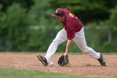 Sheehan's Peter Abate (3) charges a ground ball from Ledyard's Ty Ebdon (3)Friday at Sheehan High School during the Class M quarter finals in Wallingford  Jun. 5, 2015 | Justin Weekes / For the Record-Journal