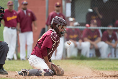 Sheehan's Paul Gozzo (20) takes a pitch off the chest Friday at Sheehan High School during the Class M quarter finals in Wallingford  Jun. 5, 2015 | Justin Weekes / For the Record-Journal