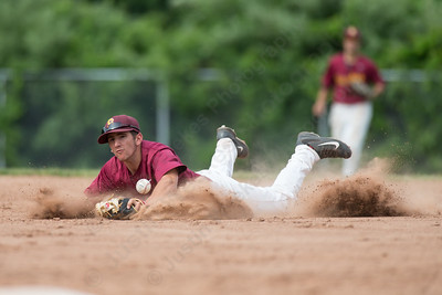 Sheehan's Peter Abate (3) dives for a shallow fly ball from Ledyard's Michael Bruce (14) Friday at Sheehan High School during the Class M quarter finals in Wallingford  Jun. 5, 2015 | Justin Weekes / For the Record-Journal