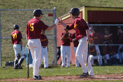 Sheehan's Kyle Brennan (12) gets a high five after scoring from teammate Nolan Cloutier (5) Monday at Sheehan High School in Wallingford  Apr. 13, 2015 | Justin Weekes / For the Record-Journal