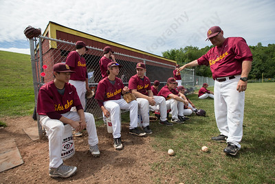 Sheehan's head coach  Matthew Altieri keeps it loose pre game Friday at Sheehan High School during the Class M quarter finals in Wallingford  Jun. 5, 2015 | Justin Weekes / For the Record-Journal