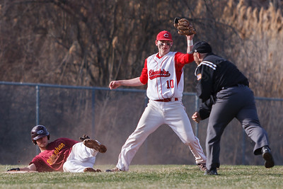 Sheehan's Brandon Rentas (31) looks back at the umpire to see if Cheshire's Cheshire's Joe Anderson (10) got the tag at third Monday at Sheehan High School in Wallingford  Apr. 13, 2015 | Justin Weekes / For the Record-Journal