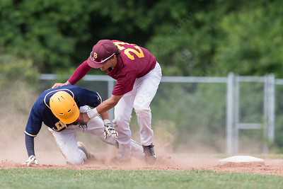 Sheehan's Sal Gozzo (27) catches Ledyard's Michael Bruce (14) leading between second and third Friday at Sheehan High School during the Class M quarter finals in Wallingford  Jun. 5, 2015 | Justin Weekes / For the Record-Journal