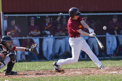 Sheehan's Nolan Cloutier (5) fouls a pitch off from Cheshire's Ben DeLaubell (11) to stay alive Monday at Sheehan High School in Wallingford  Apr. 13, 2015 | Justin Weekes / For the Record-Journal
