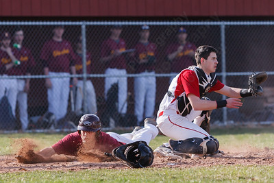 Sheehan's Brandon Rentas (31) slides across home beating the tag from Cheshire's Brandon Clark (6) Monday at Sheehan High School in Wallingford  Apr. 13, 2015 | Justin Weekes / For the Record-Journal